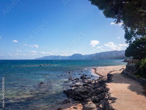 Plagát  Waterfront Cala Gonone and coastal landscape
