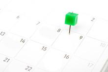 Close Up Green Pin On White Calendar.