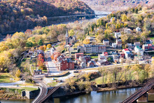Harper's Ferry Overlook Closeup Of Cityscape With Colorful Orange Yellow Foliage Fall Autumn Forest With Small Village Town By River In West Virginia, WV
