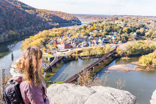 Valokuva  Hiker woman girl looking at cityscape overlook, colorful orange yellow foliage f