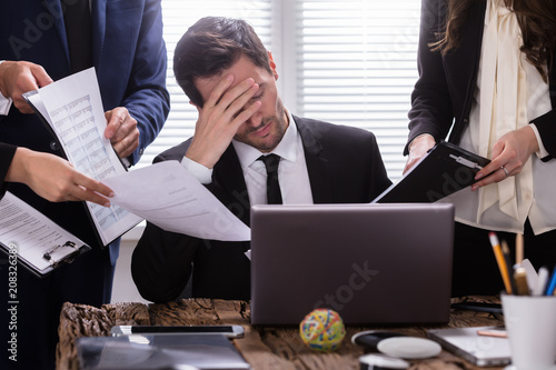 Canvastavla  Stressed Businessman Sitting In Office