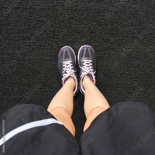 e3a948e2 Female in Purple Sneakers Shoes Isolated. Top View. Woman Wear Runner Sneakers  Urban on Cement Background