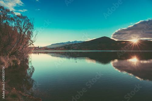 Fotobehang Groen blauw Autumn in Lake Hayes, Queenstown New Zealand landscape
