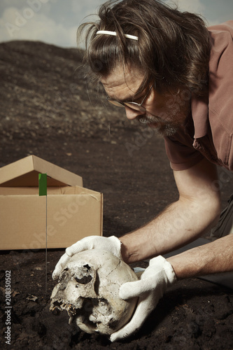 Photo Cleaning of skull from place of find on summer terrain excavations on field loca