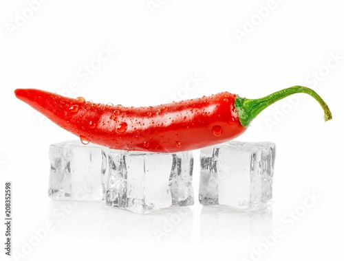 Staande foto Hot chili peppers A red chili pepper lying on ice cubes against a white background with copy space for your text