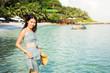 Girl enjoying day at the tropical beach