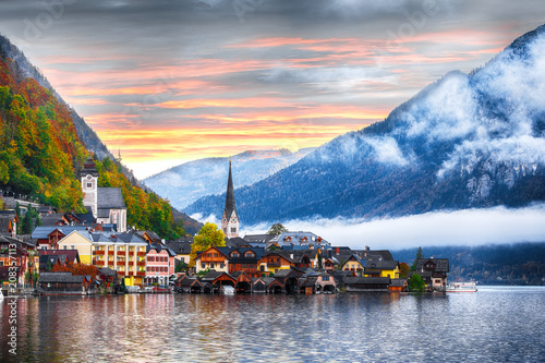 Scenic view of famous Hallstatt mountain village with Hallstatter lake. Foggy autumn sunrise on Hallstatt lake