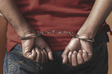 Man Under Arrest, Criminal Scence Of Man Get Caught With Handcuffed By The Policeman.