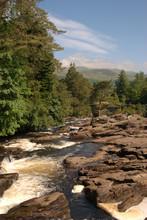 The Falls Of Dochart And Bridge At Killin In Scottish Highlands