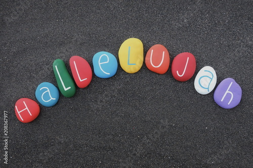 Photographie Hallelujah text composed with multi colored sea stones over black volcanic sand