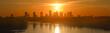 Panorama Warszawy na tle zachodzącego słońca
