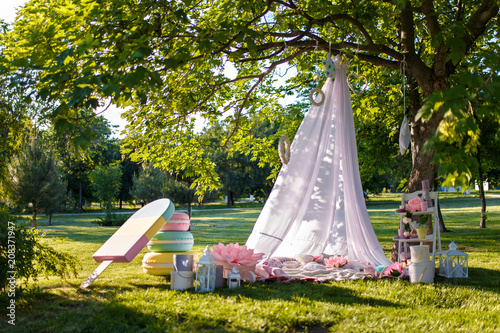 white wigwam with decorative birdcage, candles, cushions toy macaroon, toy ice c Canvas