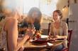 Leinwanddruck Bild - Multi-ethnic group of friends having fun while preparing lunch