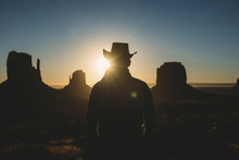 USA, Utah, Man With Cowboy Hat Enjoying Sunrise In Monument Valley