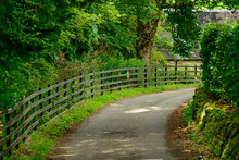 A Narrow Lane With A Wooden Fe...