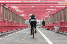 Man Riding His Bike In The Cycling Lane On Williamsburg Bridge, Brooklyn, New York City, USA.