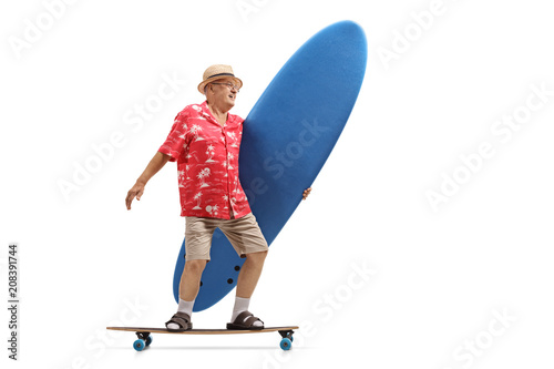 Elderly tourist holding a surfboard and riding a longboard
