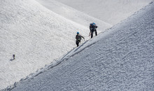 Climbers Descending Down A Steep Ridge From The Aiguille Du Midi To The Valley Blanche Below, Chamonix, Haute Savoie, Rhone Alpes, France