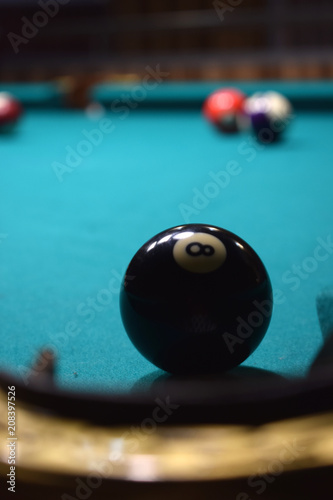 Obraz na płótnie colored balls of the American pool and cue on the billiard table
