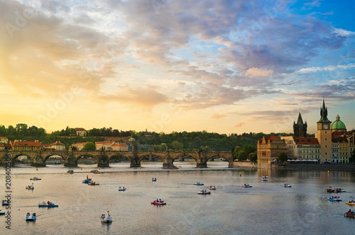 View of the famous Charles Bridge on a cloudy sky at sunset Wallpaper Mural