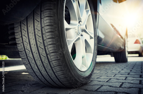 Fotomural Car tire close up, parked car low angle shot