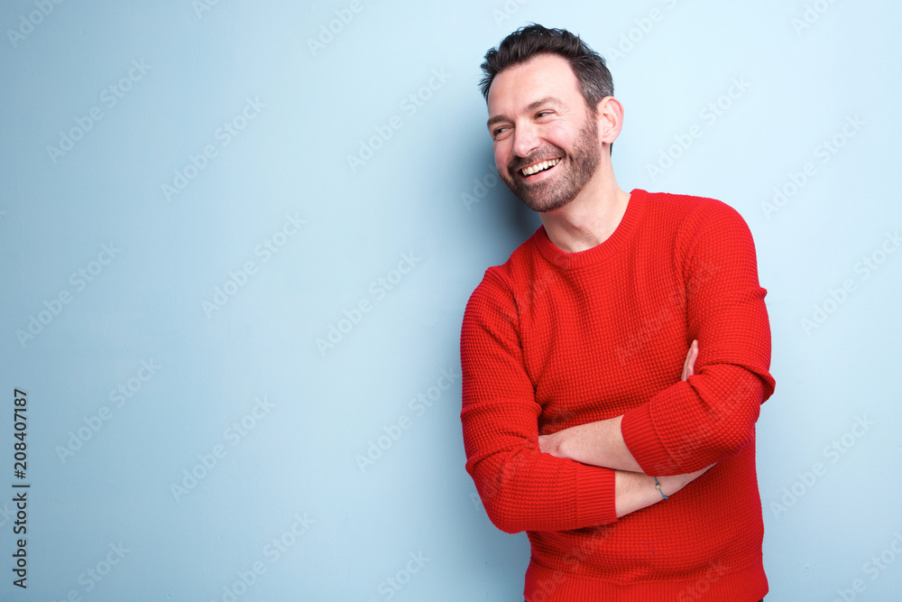 Fototapety, obrazy: cheerful man with beard laughing against blue background