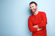 canvas print picture - cheerful man with beard laughing against blue background