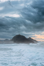 White Stormy Waves And Breakwater