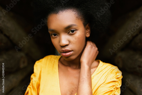 Attractive black model in yellow dress