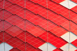 Leinwanddruck Bild - Red and white facade of modern building with geometric pattern as background, texture, abstract