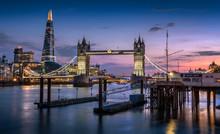 Tower Bridge, The Shard, And London Skyline At Dusk.