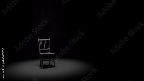 Valokuva  Metal Chair in a Spotlight in a Dark Black Room