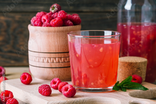 Fototapety, obrazy: kissel of raspberry, Russian traditional drink, national cuisine, fresh berries, rural style, wooden background