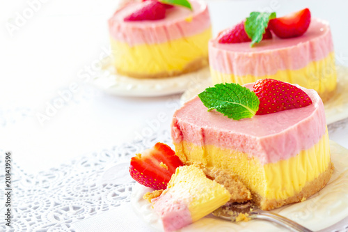 Delicious homemade mango strawberry cheesecake white background Copy space Selective focus Wallpaper Mural