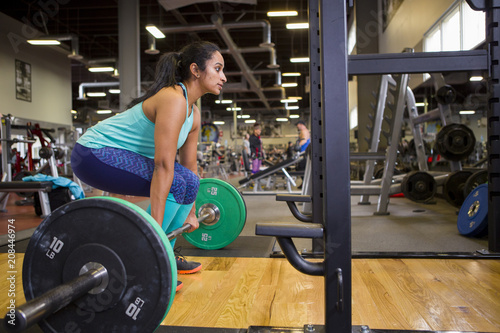 athlete lifting free weights