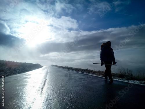 caminante camino de santiago en carretera amanecer Canvas Print