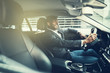 canvas print picture - Smiling African businessman driving in his car to work