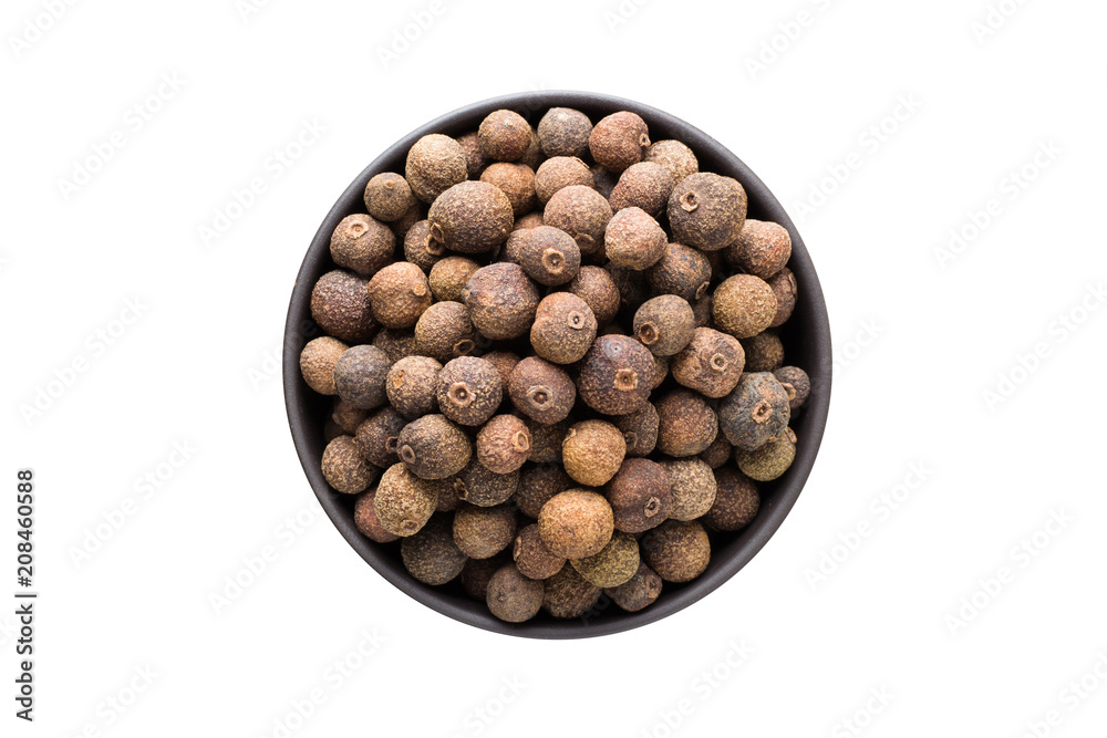 Fototapety, obrazy: allspice pepper in clay bowl isolated on white background. Seasoning or spice top view