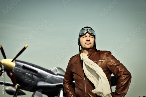Slika na platnu Portrait of a vintage pilot with leather cap, scarf and aviator glasses in front