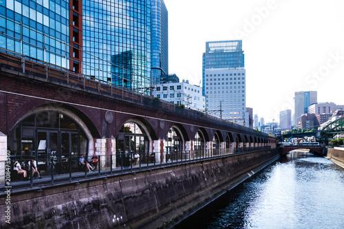 (東京都ー都市風景)万世橋から見る川沿いの風景 Poster