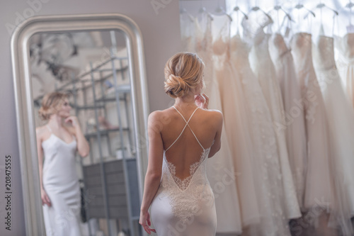 Leinwand Poster Attractive girl in a wedding shop