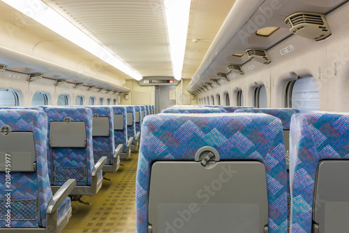 Interior of electric train with empty seats business transportation  background Canvas Print