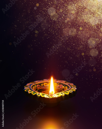 Diya lamp with golden glitter