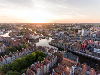 FototapetaPhoto of the old town of Gdansk architecture in sunset light. Aerial shot. Channel and buildings - top view
