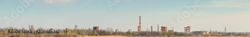 Staande foto Oude verlaten gebouwen Panorama Old Abandoned chemical factory with chimneys on the banks of the river