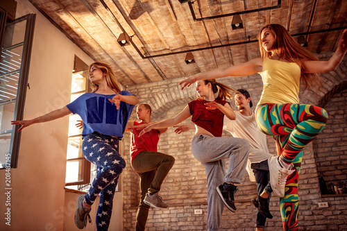 Tuinposter Dance School Passion dance team - dancer exercising dance training in studio