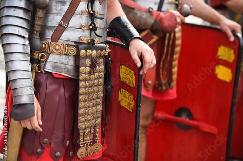 Fotografiet  Reenactment detail with roman soldiers uniforms