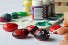 Group Of Painted Stones As Leisure Activity For Children