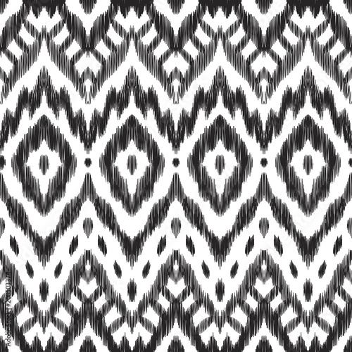 In de dag Boho Stijl The ornamental ikat pattern on ethnic style. Vector illustration in black and white colors. Exquisite seamless texture can be perfect for background images, wallpapers, textiles, wrapping papers.