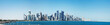 The morning panoramic view of the skyscrapers of Doha from the Persian Gulf. Futuristic skyline in the financial district of Qatar in the early morning and embankment with moored ships